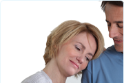 Picture of a woman resting her head on a mans shoulder